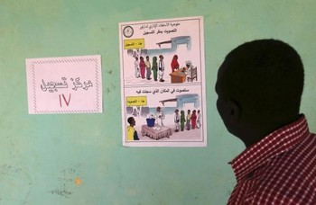 A poster for the Darfur referendum in a registration centre at Abu Shouk camp for the displaced near El Fasher, capital of North Darfur (Mohamed Nureldin Abdallah/Reuters)