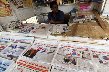 A vendor sells newspapers at a stand in Khartoum. Mohamed Nureldin Abdallah/Reuters (File photo: Nov. 12, 2012)