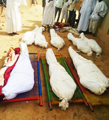 The bodies of some of the casualties are prepared for burial (RD)
