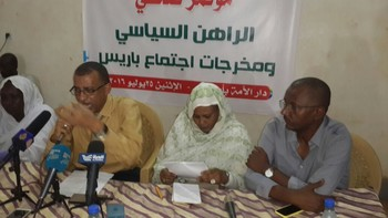 Omar El Digair (SCP) speaks at a press conference in Khartoum last July. On his left side are Maryam El Mahdi (NUP) and activist Mohamed Farouk (RD)