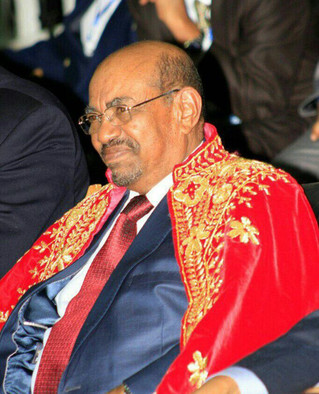 President Omar Al Bashir wears a robe during the honouring session of the African Initiative for Pride and Dignity in recognition of Bashir's efforts for the development and prosperity of Africans, Addis Ababa, Friday 29 July (RD)
