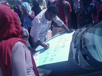 Protesters prepare a placard at a Khartoum protest last week (file photo)