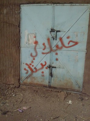 Graffiti on the doors of a shop in Kassala saying Stay at Home.17 December 2016 (RD)