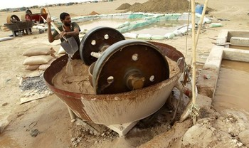 A man operates a gold crusher at a mine in Sudan's River Nile state (Mohamed Nureldin Abdallah/Reuters)
