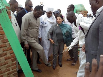 Sudan's Health Minister, Bahar Abugarda, has his shoes disinfected after a visit this month to Kario camp for South Sudanese refugees in East Darfur (File photo: Suna)
