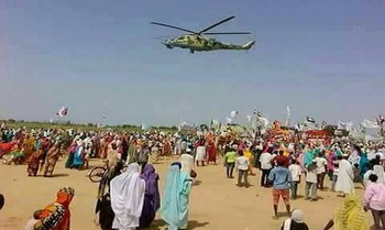 A helicopter hovers over protests at Kama Camp in South Darfur earlier this year against a visit by Sudanese President Omar Al Bashir (File photo)
