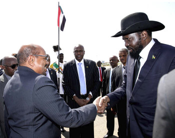 Sudan's President Omar Al Bashir greets South Sudanese President Salva Kiir Mayardit on his arrival in Khartoum on November 1 (Photo: SUNA)
