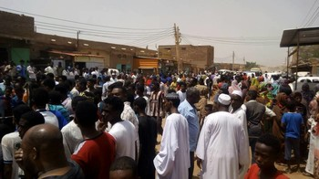 Residents gather in El Jireif East on 23 November 2017, as bulldozers and trucks arrive to demolish the brick factories (RD)