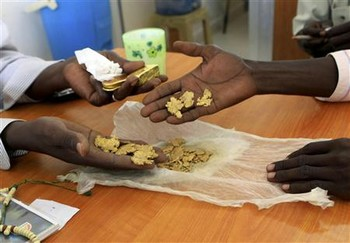 Traditional gold miners get their raw gold weighed at a gold shop in El Fasher in North Darfur (File photo)