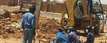 Heavy machinery is used to demolish the church building  (RD)
