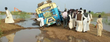 A bus stuck in mud in Darfur this month (RD)