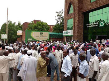 Residents queue at a bank in Khartoum on 19 August 2018 (file photo)