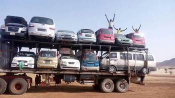Transport of cars in Darfur (Social media)