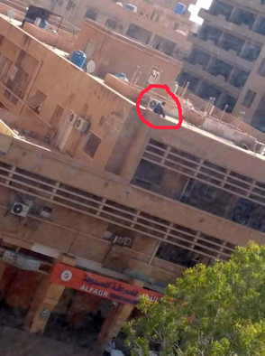 A sharpshooter on a Khartoum rooftop ahead of Tuesday's protest march