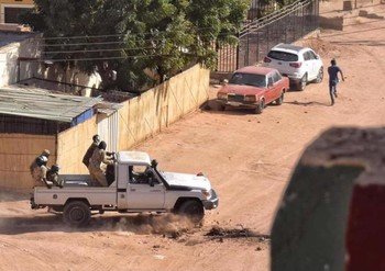 Sudanese forces pursue a lone protestor in Burri on January 6
