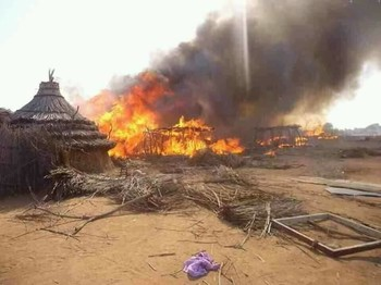 Houses burning in Darfur (file photo)