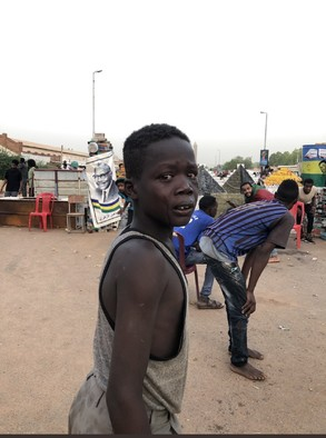 a young boy witnesses the violent break-up of the sit-in in Khartoum on June 3 which left more than 100 people dead and hundreds more injured (RD)