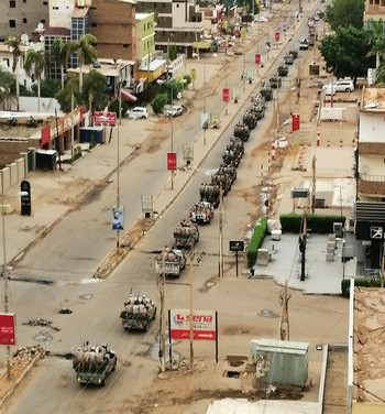 A column of RSF militia vehicles patrols the deserted Khartoum streets today