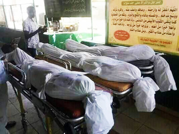 The bodies of three unidentified victims of the June 3 Khartoum massacre are prepared for burial (RD Correspondent)