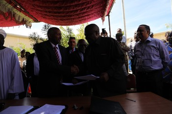 The Unamid base is handed over to Ambassador Omer Al Sanousi of the Sudanese Ministry of Foreign Affairs by Unamid Joint Special Representative Jeremiah Mamabolo (Amin Ismail/Unamid)