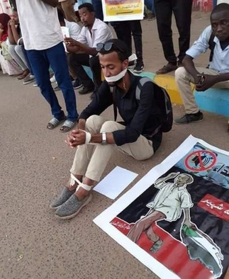 A demonstrator at a Khartoum protest march in December 2019, demanding justice for the slain demonstrators at the sit-in (RD correspondent)