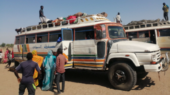 CAR refugees finally board a bus at Um Dafug to be relocated to a safer settlement in El Mashaga (Suleiman Ahmed / UNHCR)