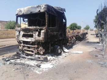 A torched truck in New Halfa (SUNA)
