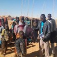 Unicef Sudan in North Darfur distributing blankets to newly displaced people (Unicef)