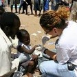 A staff member of Doctors Without Borders/Médecins Sans Frontières examines a child in Darfur (MSF)