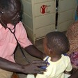 A doctor examines a child in Kadugli, capital of South Kordofan (File photo)