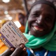 A displaced woman shows her WFP food ration card in North Darfur's Kassab camp in 2012 (Albert González Farran/Unamid)