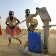 Children collect water from a water pump well in the Abyei suburb of Molomol (UN Photo/Fred Noy)