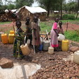 Displaced girls collect water from a shallow pool in Blue Nile state (file photo)