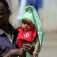 An Eritrean refugee holds his child at Shagarab refugee camp in Kassala, eastern Sudan (news.yahoo.com)