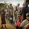 South Sudanese refugees wait in line to get food at the Dzaipi transit centre in Uganda (UNHCR)