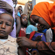 A Sudanese boy receives a vaccination against measles (C. banluta/WHO)