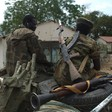 South Sudan People Liberation Army (SPLA) soldiers on a pick-up truck during a patrol in Malakal (Harrison Ngethi/AFP)