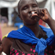 A South Sudanese woman takes oral cholera vaccine (Ali Ngethi/WHO)