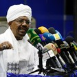 President Omar Al Bashir addresses top officials of his ruling National Congress Party during a meeting in Khartoum in August 2015 (Ashraf Shazly/AFP)