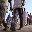 Migrants who were abandoned in the desert by human traffickers gather in the northern Sudanese city of Dongola (File photo: AFP)
