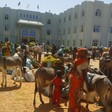 People who fled from Mouli village stand in front of the West Darfur government Secretariat in El Geneina (RD)