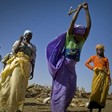 Darfuri refugees chop firewood at a distribution point in eastern Chad's Treguine camp (Fred Noy/UNHCR)