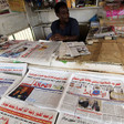 A vendor sells newspapers at a stand in Khartoum (Mohamed Nureldin Abdallah/Reuters)