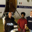 Alleged people-smuggling kingpin Mered Medhanie arrives in Rome after being extradited from Sudan (Picture: Italian Police Department)