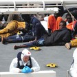 Survivors of a smuggler's boat that overturned off the coast of Libya rest on the deck of the Italian Coast Guard ship Bruno Gregoretti, in Valletta's Grand Harbour, April 20, 2015 (AP)