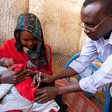 A child receives a vaccination in Sudan (Noorani / Unicef)