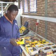 A worker checks-out new electronic measuring equipment in Sudan (File photo: EU)