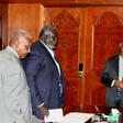 (L-R) Yasir Arman and Malik Agar of the SPLM-N take a seat at the table with AUHIP chairman Thabo Mbeki in Addis Ababa, Ethiopia (RD)