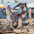A young South Sudanese refugee cooks food at a refugee camp in northern Uganda (Will Swanson-UNHCR)