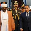 Egyptian President Abdel Fattah El Sisi (R) walks alongside Sudanese president Omar Al Bashir upon the latter's arrival ahead of an Arab League summit in March 2015 (AFP)